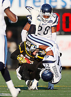 Jul 7, 2007; Hamilton, ON, CAN; Toronto Argonauts safety (21) Orlondo Steinauer tackles Hamilton Tiger-Cats wide receiver (80) Brock Ralph during the first half of the 2007 season home opener at Ivor Wynne Stadium. The Argos defeated the Tiger-Cats 30-5. Mandatory Credit: Ron Scheffler, Special to the Spectator.