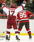 Rence Coassin (Harvard - 17) celebrates Del Mauro's goal which gave Harvard a 2-1 lead just 21 seconds after they tied the game in the second period. - The Harvard University Crimson defeated the St. Lawrence University Saints 4-3 on senior night Saturday, February 26, 2011, at Bright Hockey Center in Cambridge, Massachusetts.
