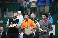 20.07.2014. Hoylake, England. (L-R) Sergio Garcia (ESP) and Rickie Fowler (USA) are joint 2nd for the championship while Rory McIlroy (NIR) of Northern Ireland, right, celebrates as the winner and holds the Claret Jug after winning the 143rd British Open Championship at Royal Liverpool Golf Club in Hoylake, England.
