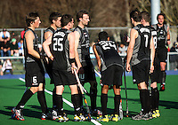 Phil Burrows calls the team together during a stoppage in play during the international hockey match between the New Zealand Black Sticks and Malaysia at Fitzherbert Park, Palmerston North, New Zealand on Sunday, 9 August 2009. Photo: Dave Lintott / lintottphoto.co.nz