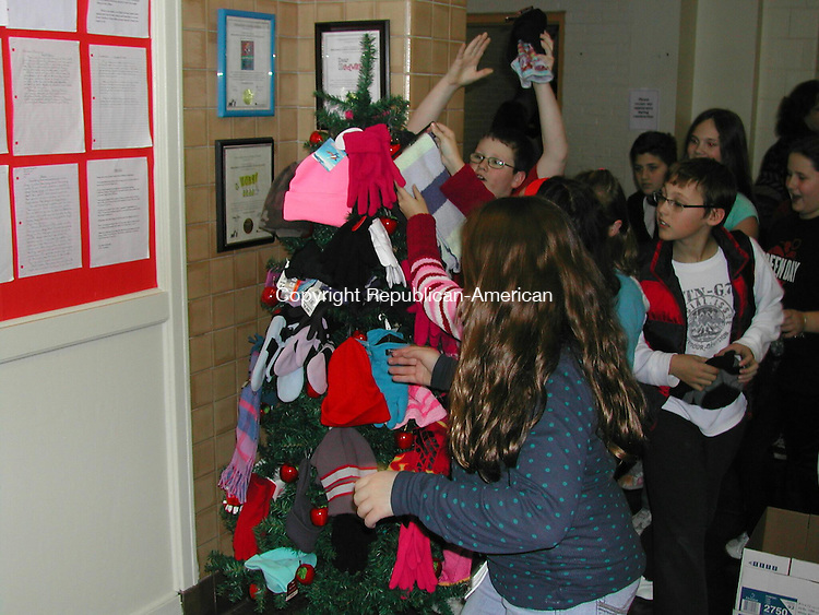 THOMASTON, CT - 11 Dec. 2008 - 121108KM03 - Thomaston Center School students start removing hats, mittens, gloves and scarves from a small Christmas tree at the school. The winter clothes were given to the Thomaston Christmas Committee, which provides donations to local needy families. Kurt Moffett Republican-American