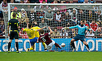 Hearts v St Johnstone....06.05.12   SPL.Andy Webster prods the ball through Alan Mannus's legs to make it 2-0.Picture by Graeme Hart..Copyright Perthshire Picture Agency.Tel: 01738 623350  Mobile: 07990 594431
