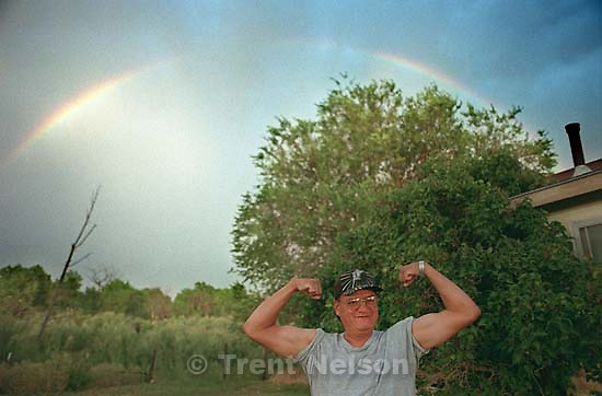 David Wopsock flexes his muscles under a rainbow.<br />