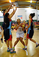 Theresa Hunt tries to shoot during the 2014 National Secondary Schools Basketball Championship AA girls' semifinal between New Plymouth Girls' High School and St Peter's College Cambridge at Arena Manawatu, Palmerston North, New Zealand on Friday, 3 October 2014. Photo: Dave Lintott / lintottphoto.co.nz