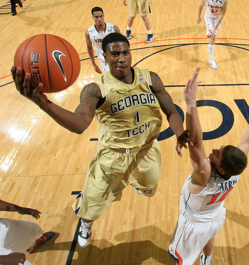 Jan. 22, 2011; Charlottesville, VA, USA; Georgia Tech Yellow Jackets guard Iman Shumpert (1) shoots over Virginia Cavaliers guard Joe Harris (12) during the game at the John Paul Jones Arena. Virginia won 72-64. Mandatory Credit: Andrew Shurtleff-US PRESSWIRE