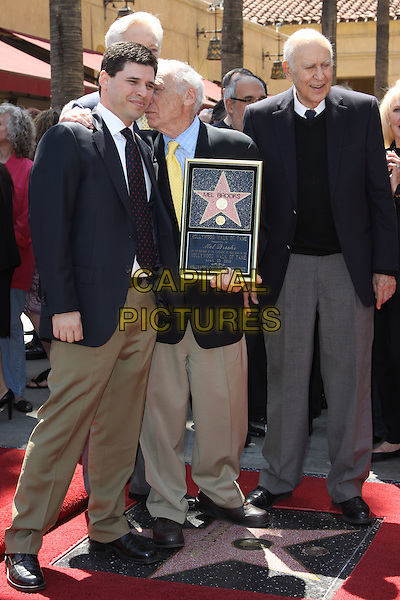 ROBERT OSBOURNE, MAX BROOKS, MEL BROOKS & CARL REINER.Mel Brooks is honoured with the 2406th star on the Hollywood Walk of Fame held On Hollywood Blvd., Hollywood, California, USA, 23 April 2010..full length blue plaid checked check suit jacket yellow tie brown beige trousers holding frame father son dad family arm around kissing kiss cheek  .CAP/ADM/KB.©Kevan Brooks/Admedia/Capital Pictures