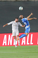 2nd July 2020, Madrid, Spain;  Real Madrid s Dani Carvajal L and Getafe s David Timor vie for the ball during a Spanish league football match between Real Madrid and Getafe in Madrid, Spain