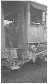 Fireman shoveling coal into K-37 #497 firebox.<br /> D&amp;RGW    5/1963