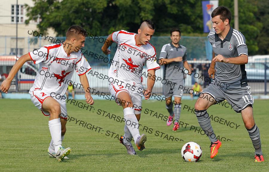 Fudbal Jelen Super League season 2014-2015<br /> Vozdovac v Partizan<br /> Nikola Ninkovic (R) Tome Kitanovski (C) and Predrag Stanimirovic (L)<br /> Beograd, 08.10.2014.<br /> foto: Srdjan Stevanovic/Starsportphoto&copy;