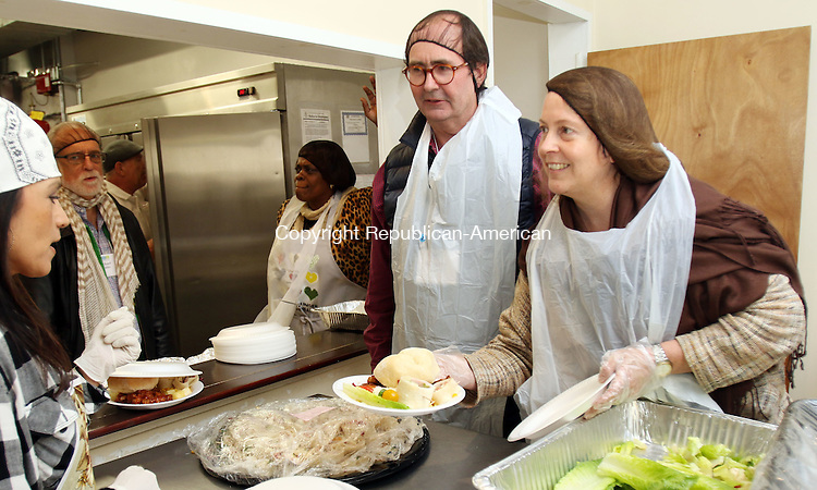 WATERBURY CT. 31 October 2016-103116SV07-From left, Humphry Rollesgon of Litchfield and Karen Reddington-Hughes of Woodbury serve food at the Greater Waterbury Interfaith Ministries soup kitchen in Waterbury Monday. They are part of the Western Connecticut Leadership group sponsored by the Connecticut Community Foundation. <br /> Steven Valenti Republican-American