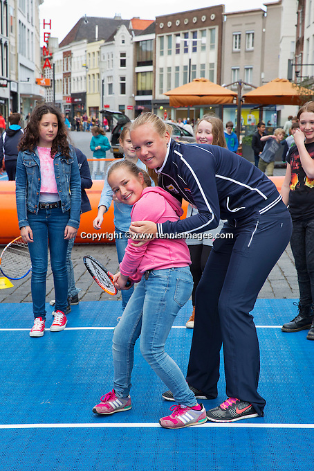 April 17, 2015, Netherlands, Den Bosch, Maaspoort, Fedcup Netherlands-Australia,  Kiki Bertens (NED) playing street tennis with schoolkids<br /> Photo: Tennisimages/Henk Koster