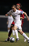 Duke's Danny Kramer (24) pushes past NC State's Ernesto Di Laudo (behind) on Friday, October 21st, 2005 at Koskinen Stadium in Durham, North Carolina. The Duke University Blue Devils defeated the North Carolina State University Wolfpack 6-0 during an NCAA Division I Men's Soccer game.