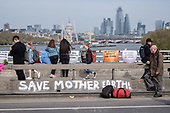 Save Mother Earth graffiti.  Extinction Rebellion climate change campaigners occupy Waterloo Bridge, London.