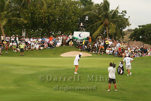 Kapolei, HI, February 24, 2006 - The gallery watches as Michelle Wie chips onto the green during the 2nd round of the LPGA Fields Open at Ko Olina Resort...Mandatory Photo Credit: Darrell Miho, US Presswire