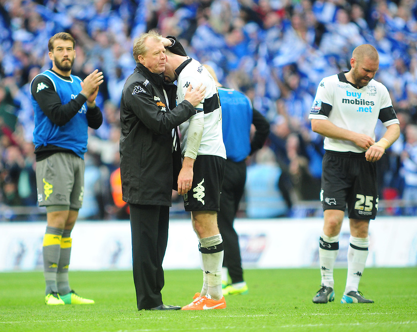 Derby County's Manager Steve McClaren hugs a distraught Richard Keogh at the end of the game<br /> <br /> Photographer Chris Vaughan/CameraSport<br /> <br /> Football - The Football League Sky Bet Championship Play-Off Final - Derby County v Queens Park Rangers - Saturday 24th May 2014 - Wembley Stadium - London<br /> <br /> &copy; CameraSport - 43 Linden Ave. Countesthorpe. Leicester. England. LE8 5PG - Tel: +44 (0) 116 277 4147 - admin@camerasport.com - www.camerasport.com
