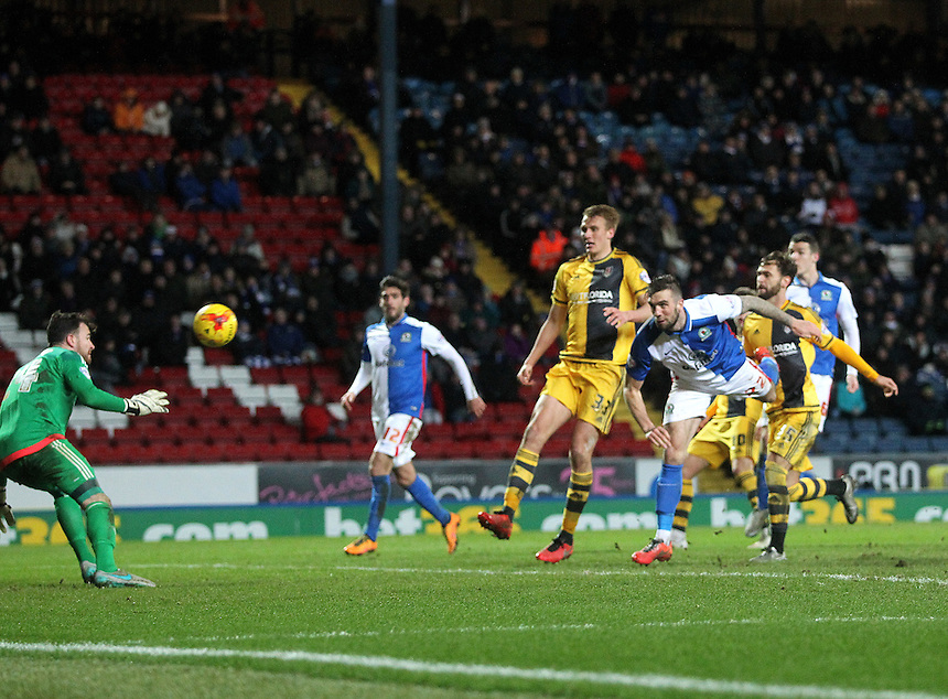 Blackburn Rovers Shane Duffy scores his sides second goal  beating Fulham's Andy Lonergan<br />