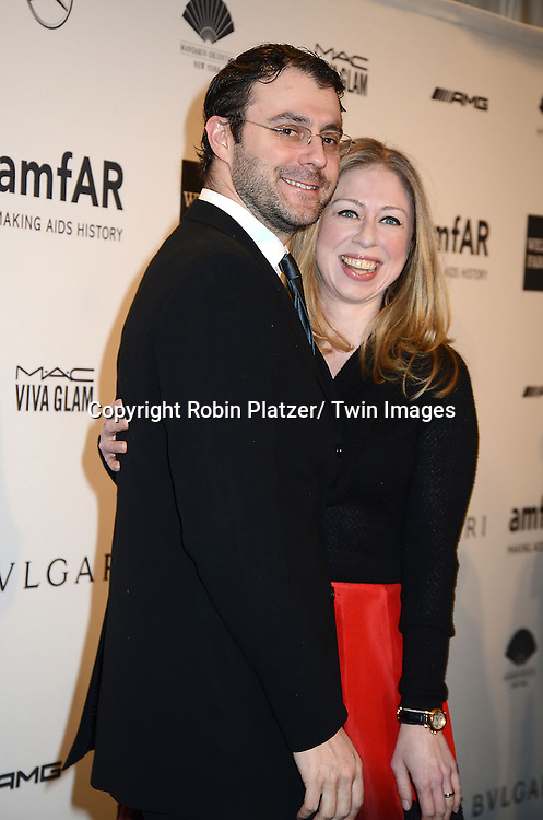 Chelsea Clinton and husband Marc Mezvinsky attends the amfAR New York Gala on February 5, 2014 at Cipriani Wall Street in New York City.