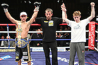 John Murray (Black Shorts) stops Andriy Kudriavtsev (White shorts) in the 9th round at Robin Park Centre, Wigan, promoted by Matchroom Sports - 25/09/10 - MANDATORY CREDIT: Chris Royle