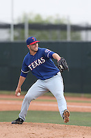 Josh McElwee #60 of the Texas Rangers pitches during a Minor League Spring Training Game against the Kansas City Royals at the Kansas City Royals Spring Training Complex on March 20, 2014 in Surprise, Arizona. (Larry Goren/Four Seam Images)