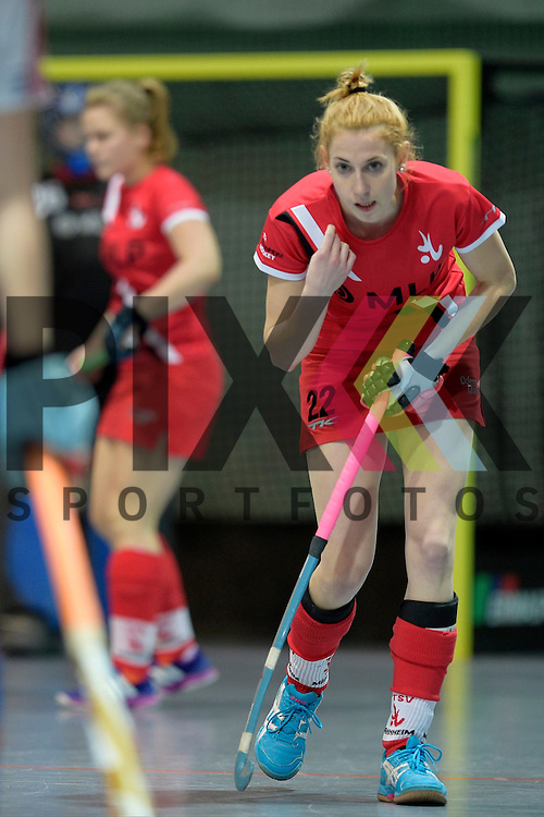 GER - Mannheim, Germany, December 05: During the 1. Bundesliga Sued Damen indoor hockey match between Mannheimer HC (white) and TSV Mannheim (red) on December 5, 2015 at Irma-Roechling-Halle in Mannheim, Germany. Final score 7-1 (HT 5-0).  Olivia Ulrich #22 of TSV Mannheim<br /> <br /> Foto &copy; PIX-Sportfotos *** Foto ist honorarpflichtig! *** Auf Anfrage in hoeherer Qualitaet/Aufloesung. Belegexemplar erbeten. Veroeffentlichung ausschliesslich fuer journalistisch-publizistische Zwecke. For editorial use only.
