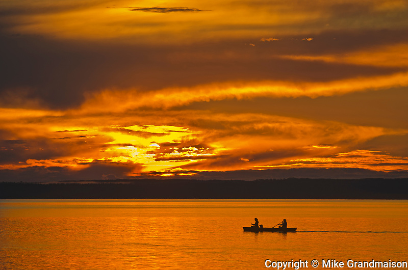 Canoeing on Clear Lake at sunset<br />Riding Mountain National Park<br />Manitoba<br />Canada