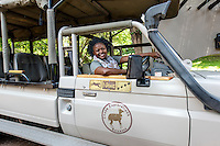 Africa, Botswana, Kasane, Chobe Game Lodge, Chobe National Park. Malebogo Lebo Kgoleng, One of Chobe Game Lodge women guides in her vehicle.