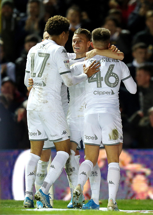 Leeds United's Ezgjan Alioski (centre) celebrates with team-mates Helder Costa (left) and Jamie Shackleton after scoring sides opening goal<br /> <br /> Photographer Rich Linley/CameraSport<br /> <br /> The EFL Sky Bet Championship - Tuesday 1st October 2019  - Leeds United v West Bromwich Albion - Elland Road - Leeds<br /> <br /> World Copyright © 2019 CameraSport. All rights reserved. 43 Linden Ave. Countesthorpe. Leicester. England. LE8 5PG - Tel: +44 (0) 116 277 4147 - admin@camerasport.com - www.camerasport.com