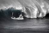 USA, Hawaii, Maui, a man windsurfs on huge waves at a break called Jaws or Peahi (B&W)