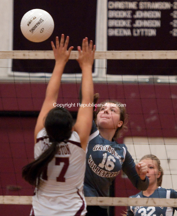TORRINGTON, CT-100814JS16-  Naugatuck's Nicole Healy (16) spikes the ball past Torrington's Jayleen Colon (17) during their match Wednesday at Torrington High School. <br /> Jim Shannon Republican-American