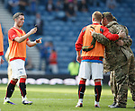 Nicky Clark taking pictures of the troops at half-time