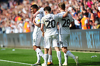 Kyle Naughton (left) of Swansea City celebrates scoring his side's third goal with team mates during the Sky Bet Championship match between Swansea City and Rotherham United at the Liberty Stadium in Swansea, Wales, UK.  Friday 19 April 2019