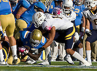Sean Cattouse of California tackles Derrick Coleman of UCLA during the game at Rose Bowl in Pasadena, California on October 29th, 2011.  UCLA defeated California, 31-14.