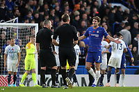 Marcos Alonso of Chelsea has words with referee, Kevin Friend, at the final whistle during Chelsea vs Everton, Premier League Football at Stamford Bridge on 11th November 2018