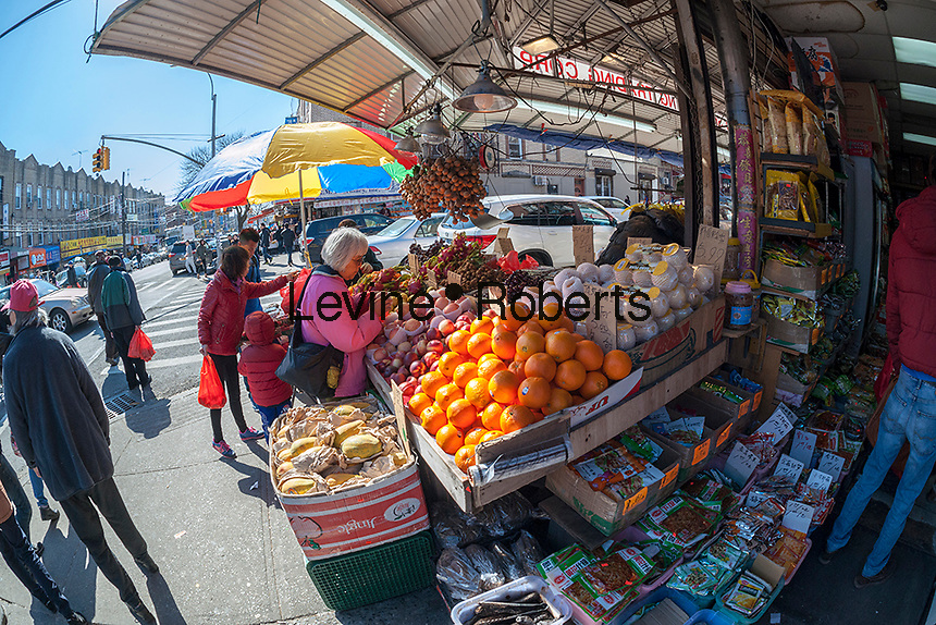 Fruit and vegetable grocer on Eighth Avenue in the Sunset Park neighborhood in Brooklyn in New York on Sunday, February 28, 2016 during the Lantern Festival street fair. Sunset Park has become Brooklyn's Chinatown as Chinese and other Asian groups have moved there and businesses have sprouted up to cater to them. (© Richard B. Levine)