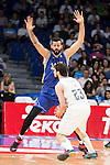Real Madrid's Sergio Llull and UCAM Murcia's Faverani during the first match of the playoff at Barclaycard Center in Madrid. May 27, 2016. (ALTERPHOTOS/BorjaB.Hojas)