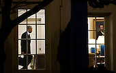 United States President Barack Obama walks out of the Oval Office toward the Residence while departing the White House, on January 28, 2016 in Washington, DC. President Obama is traveling to Baltimore, MD to deliver remarks and answer questions at the House Democratic Issues Conference. <br /> Credit: Olivier Douliery / Pool via CNP