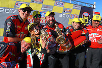 Feb 26, 2017; Chandler, AZ, USA; NHRA top fuel driver Leah Pritchett is picked up by her crew members as they celebrate after winning the Arizona Nationals at Wild Horse Pass Motorsports Park. Mandatory Credit: Mark J. Rebilas-USA TODAY Sports
