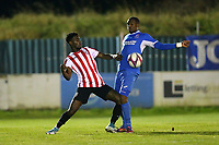 Yemi Adelani of Clapton and Jonathan Mbamarah of Redbridge during Redbridge vs Clapton, Essex Senior League Football at Oakside Stadium on 14th November 2017