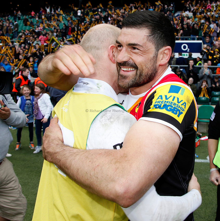 Photo: Richard Lane/Richard Lane Photography. London Wasps v Gloucester. The Stinger at Twickenham Stadium. Aviva Premiership. 19/04/2014. Wasps' Andrea Masi celebrates victory with Joe Simpson.