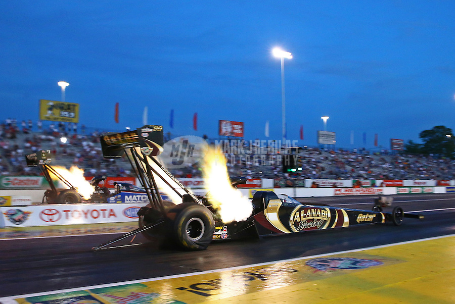 May 31, 2013; Englishtown, NJ, USA: NHRA top fuel dragster driver Khalid Albalooshi (near lane) races alongside Antron Brown during qualifying for the Summer Nationals at Raceway Park. Mandatory Credit: Mark J. Rebilas-