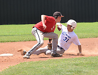 RICK PECK/SPECIAL TO MCDONALD COUNTY PRESS McDonald County shortstop Nevin Price tags out a Carthage runner during McDonald County's 4-0 win in the Lee Smith Shoot-Out held June 28-29 at McDonald County High School.