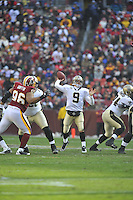 06 December 2009:  Saints QB Drew Brees (9) throws..The New Orleans Saints defeated the Washington Redskins  33-30 in Overtime to improve to 12-0 on the season at FedEx Field in Landover, MD.