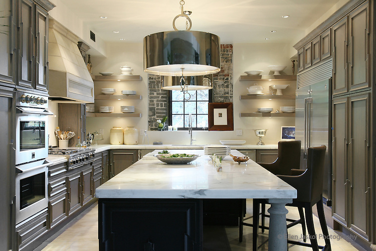 Custom Cabinets And Calcutta Gold Carrera Marble Countertops In The Kitchen  Of John Moinzad And David