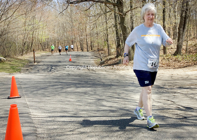 WATREBURY CT. 04 May 2015-050415SV03-Cathy Troisi of Cohoes NY. runs in the Oh Boy Marathon in Hamilton Park in Waterbury Monday. <br /> Steven Valenti Republican-American