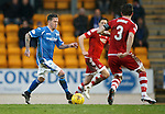 St Johnstone v Aberdeen...06.02.16   SPFL   McDiarmid Park, Perth<br /> Danny Swanson is closed down by Graeme Shinnie<br /> Picture by Graeme Hart.<br /> Copyright Perthshire Picture Agency<br /> Tel: 01738 623350  Mobile: 07990 594431
