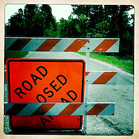 A road near a flooded field is closed near Birds Point Levee in Mississippi County, Mo., on May 21, 2011.
