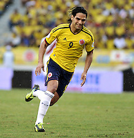BARRANQUILLA - COLOMBIA - 11 -06-20: Radamel Falcao Garcia, delantero de Colombia en accion durante partido en el estadio Metropolitano Roberto Melendez de la ciudad de Barranquilla, junio 11 de 2013. Colombia y Peru disputan partido en la fecha 14 de la jornada clasificatoria a la Copa Mundo FIFA Brasil 2014.(Foto: VizzorImage / Luis Ramirez / Staff). Radamel Falcao Garcia, forward of Colombia in action during a game in the Metropolitan stadium Roberto Melendez in Barranquilla, June 11, 2013. Colombia and Peru disputing a match on the date 14 of the qualifying for FIFA World Cup Brazil 2014. (Photo: VizzorImage / Luis Ramirez / Staff.)