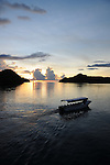 Palau, Micronesia -- Boat in sunset.