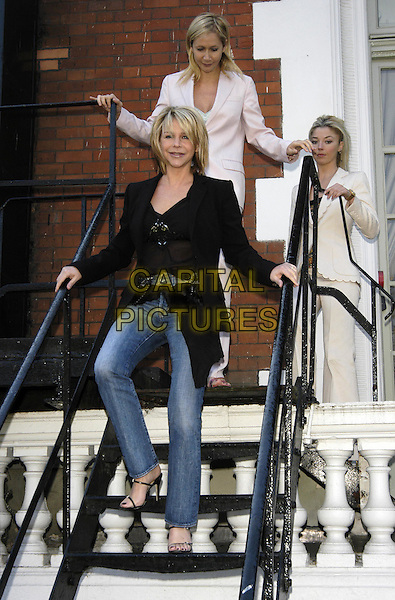 LESLIE ASH, TANIA BRYER & TAMARA BECKWITH.Tommy's Parent Friendly Awards at the Mandarin Oriental, Knightsbridge.31 March 2004.full length, full-length, denim jeans, black top.www.capitalpictures.com.sales@capitalpictures.com.©Capital Pictures