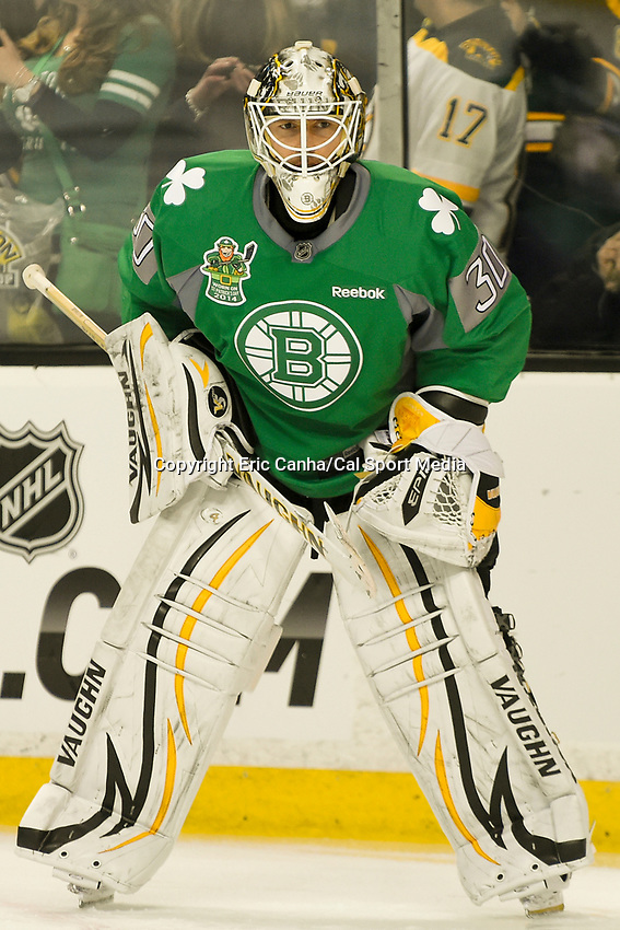 March 17, 2014 - Boston, Massachusetts , U.S. - Boston Bruins goalie Chad Johnson (30) dons a green jersey in celebration of Saint Patrick's Day during the warm up period before the NHL game between the Minnesota Wild and the Boston Bruins held at TD Garden in Boston Massachusetts. The Bruins defeated the Wild 4-1 at the end of regulation.  Eric Canha/CSM